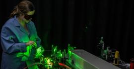 Researcher in dark room