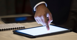 Person touching front of digital tablet