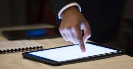 Person scrolling through digital tablet